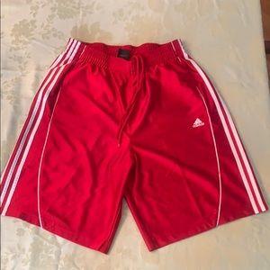 Red adidas athletic shorts